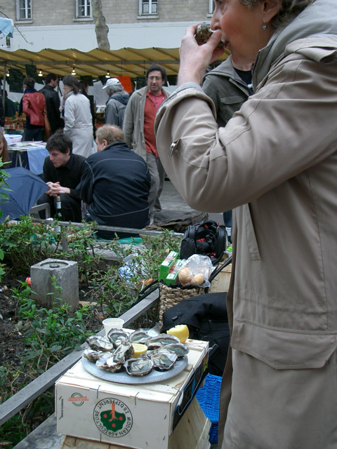 madam samples oysters and wine on the go